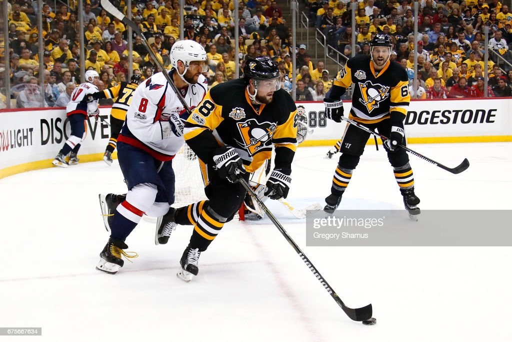 Brian Dumoulin #8 of the Pittsburgh Penguins heads up ice in front of Alex Ovechkin #8 of the Washington Capitals in Game Three of the Eastern Conference Second Round during the 2017 NHL Stanley Cup Playoffs at PPG Paints Arena on May 1, 2017 in Pittsburgh, Pennsylvania. Washington won the game 3-2 in overtime.