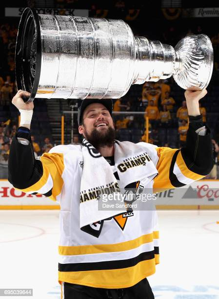 Brian Dumoulin of the Pittsburgh Penguins lifts the Stanley Cup after the Penguins defeated the Nashville Predators 20 to win Game Six of the 2017...