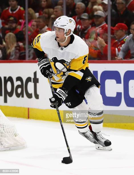 Brian Dumoulin of the Pittsburgh Penguins looks to pass against the Chicago Blackhawks during the season opening game at the United Center on October...