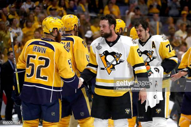 Brian Dumoulin of the Pittsburgh Penguins shakes hands with Matt Irwin of the Nashville Predators after Game Six of the 2017 NHL Stanley Cup Final at...