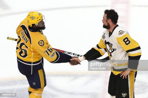 Brian Dumoulin of the Pittsburgh Penguins shakes hands with PK Subban of the Nashville Predators after winning Game Six of the 2017 NHL Stanley Cup...