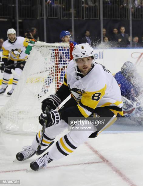Brian Dumoulin of the Pittsburgh Penguins skates against the New York Rangers at Madison Square Garden on October 17 2017 in New York City The...