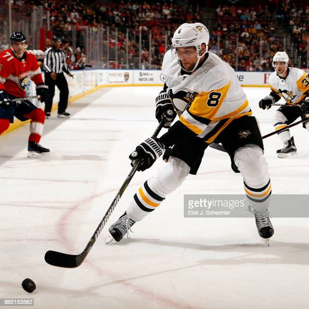 Brian Dumoulin of the Pittsburgh Penguins skates for the puck against the Florida Panthers at the BBT Center on October 20 2017 in Sunrise Florida
