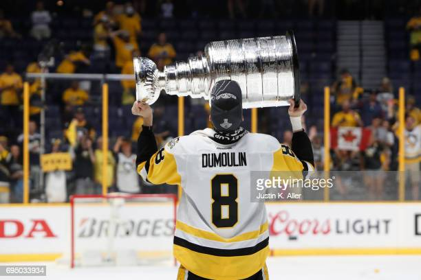 Brian Dumoulin of the Pittsburgh Penguins skates with the Stanley Cup after their teams 20 victory over the Nashville Predators to win Game Six of...