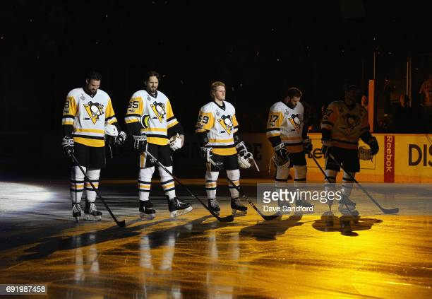 Brian Dumoulin Ron Hainsey Jake Guentzel Bryan Rust and Sidney Crosby of the Pittsburgh Penguins stand on the ice before playing against the...