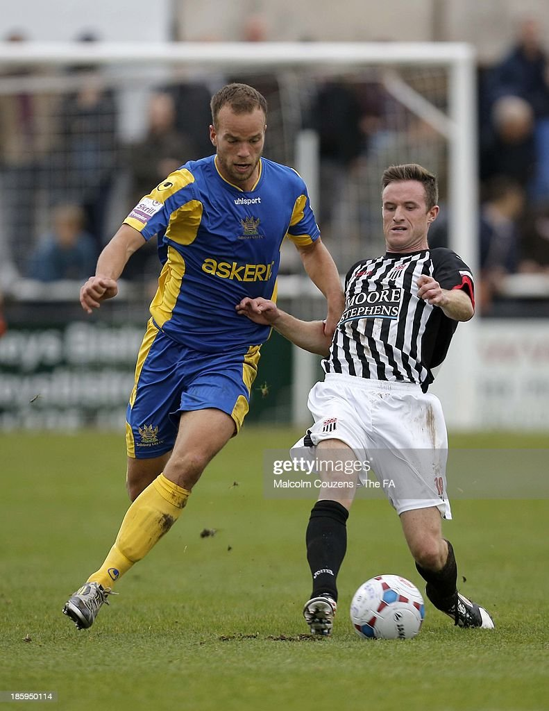 Brian Dutton of Salisbury (L) and Andy Watkins of Bath City compete for the ball during the FA Cup fourth qualifying round match between Bath City and Salisbury at Twerton Park on October 26, 2013 in Bath, England.