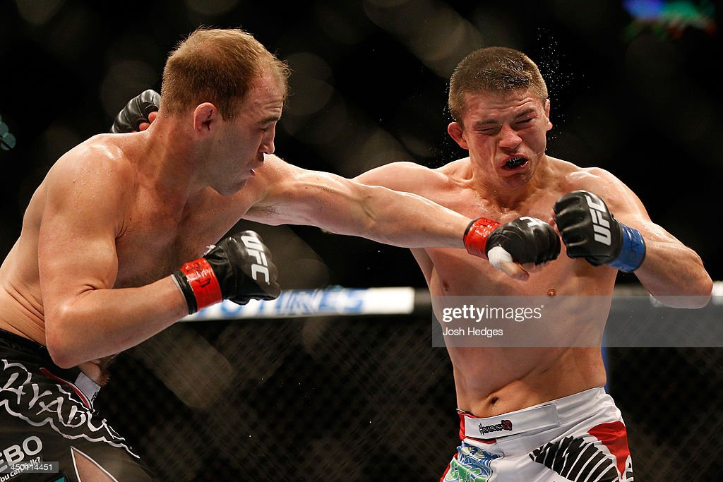 Brian Ebersole punches Rick Story in their welterweight bout during the UFC 167 event inside the MGM Grand Garden Arena on November 16, 2013 in Las Vegas, Nevada.
