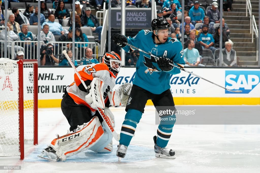Brian Elliot #37 of the Philadelphia Flyers defends against Logan Couture #39 of the San Jose Sharks during a NHL game at SAP Center at San Jose on October 4, 2017 in San Jose, California.