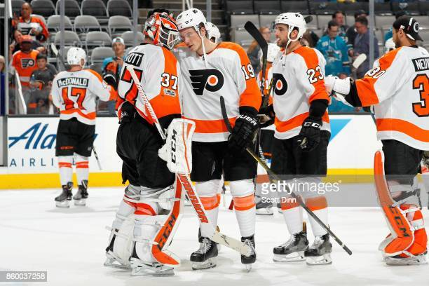 Brian Elliot Patrick Nolan Brandon Manning of the Philadelphia Flyers celebrate their win over the San Jose Sharks after a NHL game at SAP Center at...
