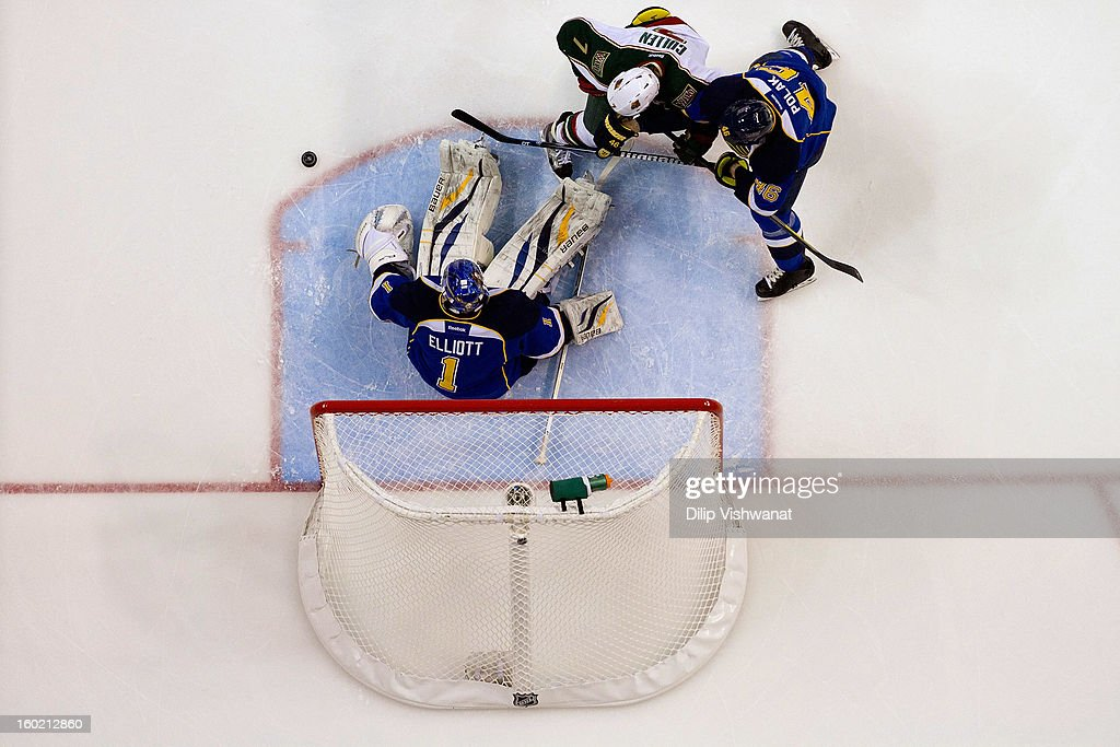 Brian Elliott #1 and Roman Polak #46 of the St. Louis Blues defend against Matt Cullen #7 of the Minnesota Wild at the Scottrade Center on January 27, 2013 in St. Louis, Missouri.