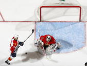 Brian Elliott of the Ottawa Senators makes a pad save with Stephen Weiss of the Florida Panthers at the top of the crease looking for a rebound in a...