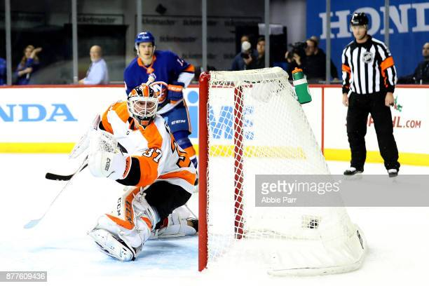 Brian Elliott of the Philadelphia Flyers gives up a goal to Johnny Boychuk of the New York Islanders in the second period during their game at...