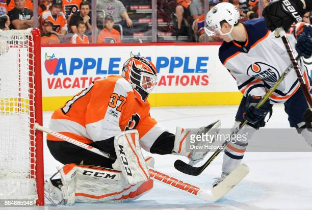 Brian Elliott of the Philadelphia Flyers Kailer Yamamoto of the Edmonton Oilers at the Wells Fargo Center on October 21 2017 in Philadelphia...