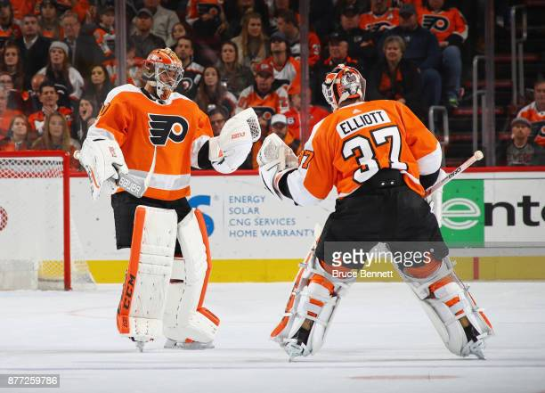 Brian Elliott of the Philadelphia Flyers takes over netminding duties from Michal Neuvirth during the second period against the Vancouver Canucks at...