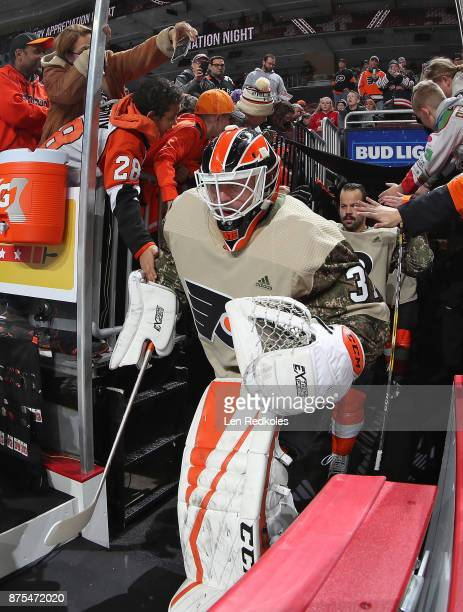 Brian Elliott of the Philadelphia Flyers wearing a camouflage jersey in honor of Military Appreciation night enters the ice surface for warmups...