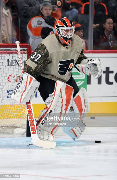Brian Elliott of the Philadelphia Flyers wearing a camouflage jersey in honor of Military Appreciation night warms up against the Minnesota Wild on...