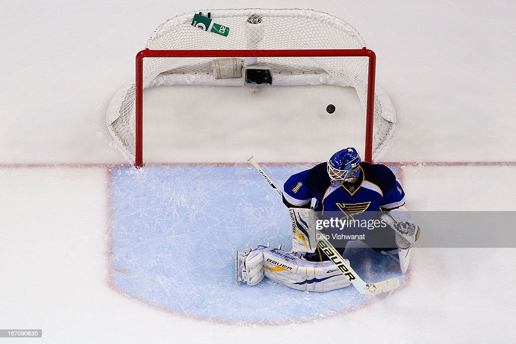 <a gi-track='captionPersonalityLinkClicked' href=/galleries/search?phrase=Brian+Elliott&family=editorial&specificpeople=687032 ng-click='$event.stopPropagation()'>Brian Elliott</a> #1 of the St. Louis Blues allows a goal against <a gi-track='captionPersonalityLinkClicked' href=/galleries/search?phrase=Antoine+Roussel&family=editorial&specificpeople=4202700 ng-click='$event.stopPropagation()'>Antoine Roussel</a> #60 of the Dallas Stars during the third period at the Scottrade Center on April 19, 2013 in St. Louis, Missouri. The Blues beat the Stars 2-1.