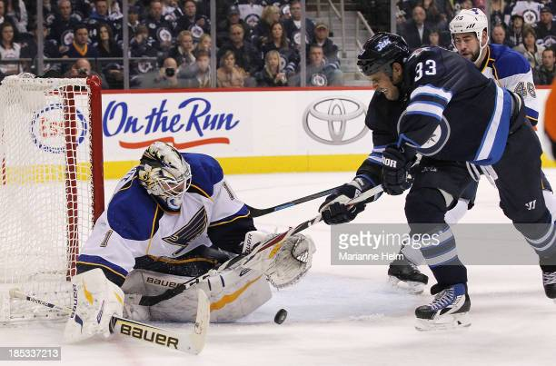 Brian Elliott of the St Louis Blues blocks a shot on goal by Dustin Byfuglien of the Winnipeg Jets in secondperiod action of an NHL game at the MTS...
