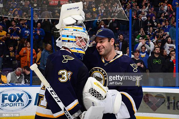 Brian Elliott of the St Louis Blues congratulated Jake Allen after defeating the Dallas Stars on December 26 2015 at Scottrade Center in St Louis...