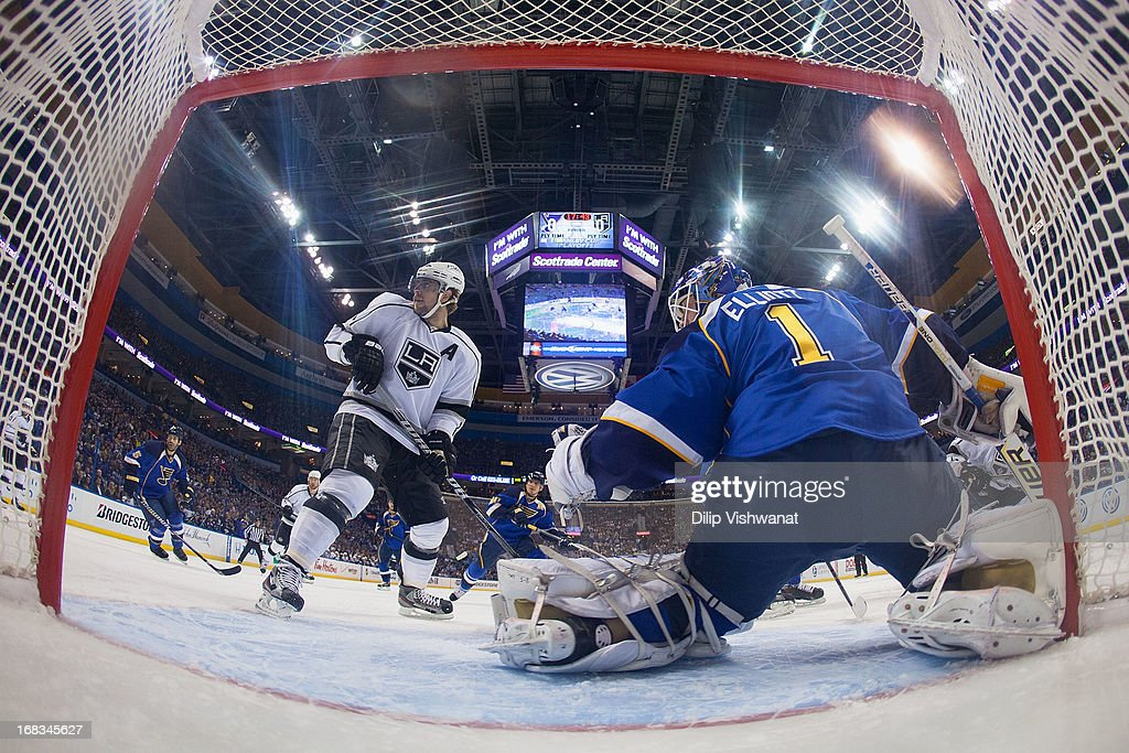 <a gi-track='captionPersonalityLinkClicked' href=/galleries/search?phrase=Brian+Elliott&family=editorial&specificpeople=687032 ng-click='$event.stopPropagation()'>Brian Elliott</a> #1 of the St. Louis Blues defends the goal against <a gi-track='captionPersonalityLinkClicked' href=/galleries/search?phrase=Matt+Greene&family=editorial&specificpeople=536126 ng-click='$event.stopPropagation()'>Matt Greene</a> #2 of the Los Angeles Kings in Game Five of the Western Conference Quarterfinals during the 2013 NHL Stanley Cup Playoffs at the Scottrade Center on May 8, 2013 in St. Louis, Missouri. The Kings beat the blues 3-2 in overtime.