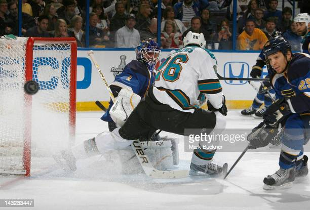 Brian Elliott of the St Louis Blues defends the net against Michal Handzus of the San Jose Sharks in Game Five of the Western Conference...