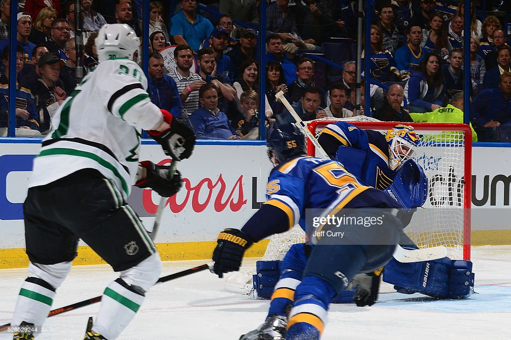 <a gi-track='captionPersonalityLinkClicked' href=/galleries/search?phrase=Brian+Elliott&family=editorial&specificpeople=687032 ng-click='$event.stopPropagation()'>Brian Elliott</a> #1 of the St. Louis Blues gives up the game winning goal in overtime to <a gi-track='captionPersonalityLinkClicked' href=/galleries/search?phrase=Cody+Eakin&family=editorial&specificpeople=5662792 ng-click='$event.stopPropagation()'>Cody Eakin</a> #20 of the Dallas Stars in Game Four of the Western Conference Second Round during the 2016 NHL Stanley Cup Playoffs at the Scottrade Center on May 5, 2016 in St. Louis, Missouri.