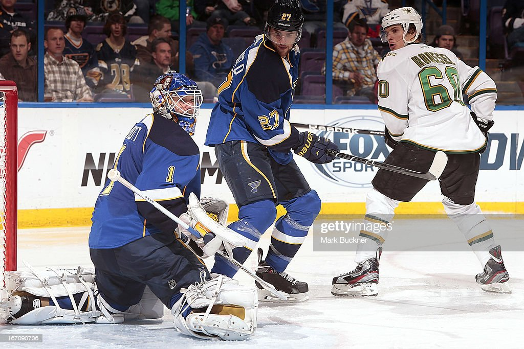 <a gi-track='captionPersonalityLinkClicked' href=/galleries/search?phrase=Brian+Elliott&family=editorial&specificpeople=687032 ng-click='$event.stopPropagation()'>Brian Elliott</a> #1 of the St. Louis Blues looks for a rebound as teammate <a gi-track='captionPersonalityLinkClicked' href=/galleries/search?phrase=Alex+Pietrangelo&family=editorial&specificpeople=4072229 ng-click='$event.stopPropagation()'>Alex Pietrangelo</a> #27 of the helps defend against <a gi-track='captionPersonalityLinkClicked' href=/galleries/search?phrase=Antoine+Roussel&family=editorial&specificpeople=4202700 ng-click='$event.stopPropagation()'>Antoine Roussel</a> #60 of the Dallas Stars in an NHL game on April 19, 2013 at Scottrade Center in St. Louis, Missouri.