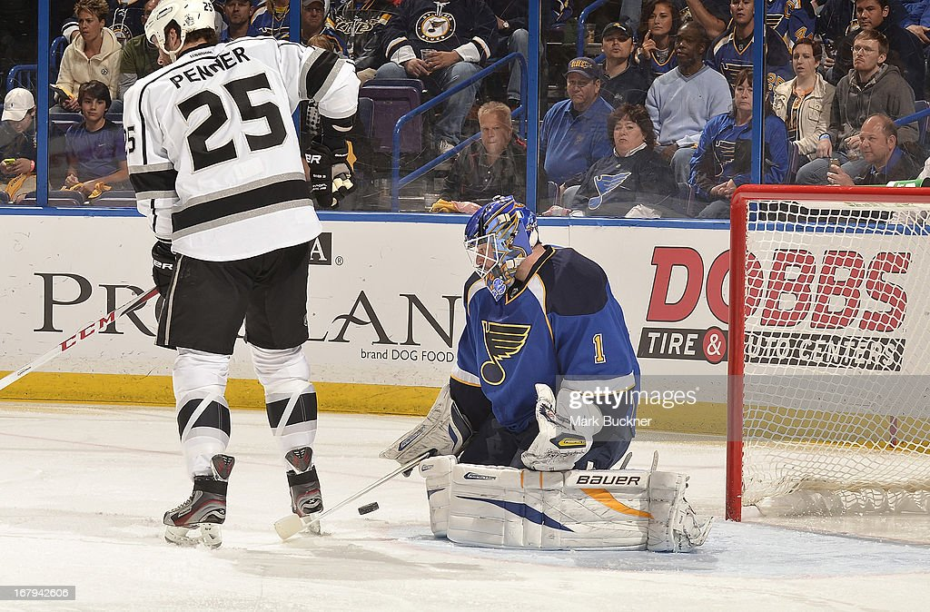 <a gi-track='captionPersonalityLinkClicked' href=/galleries/search?phrase=Brian+Elliott&family=editorial&specificpeople=687032 ng-click='$event.stopPropagation()'>Brian Elliott</a> #1 of the St. Louis Blues makes a save against a shot by <a gi-track='captionPersonalityLinkClicked' href=/galleries/search?phrase=Dustin+Penner&family=editorial&specificpeople=589919 ng-click='$event.stopPropagation()'>Dustin Penner</a> #25 of the Los Angeles Kings in Game Two of the Western Conference Quarterfinals during the 2013 NHL Stanley Cup Playoffs on May 2, 2013 at Scottrade Center in St. Louis, Missouri.