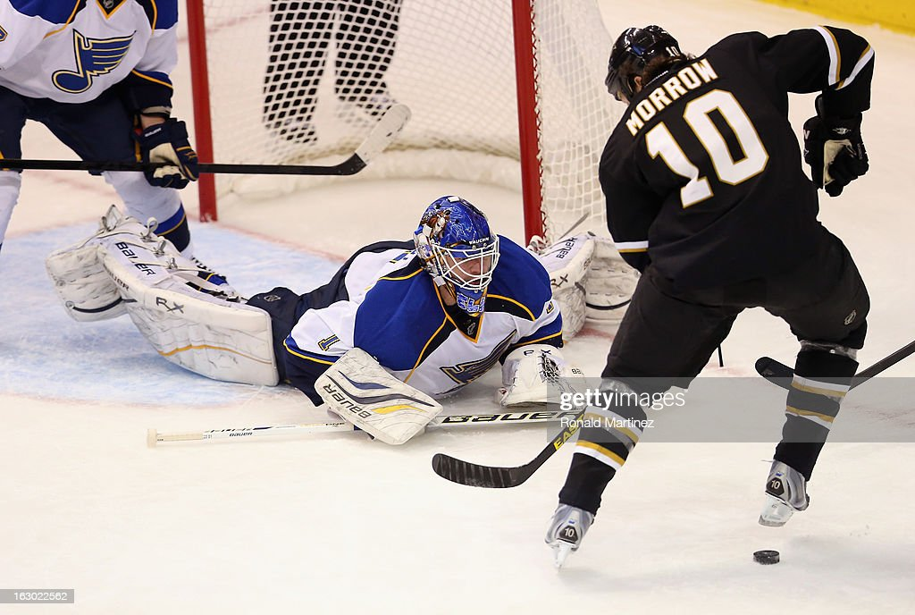 <a gi-track='captionPersonalityLinkClicked' href=/galleries/search?phrase=Brian+Elliott&family=editorial&specificpeople=687032 ng-click='$event.stopPropagation()'>Brian Elliott</a> #1 of the St. Louis Blues makes a save against Brenden Morrow #10 of the Dallas Stars at American Airlines Center on March 3, 2013 in Dallas, Texas.