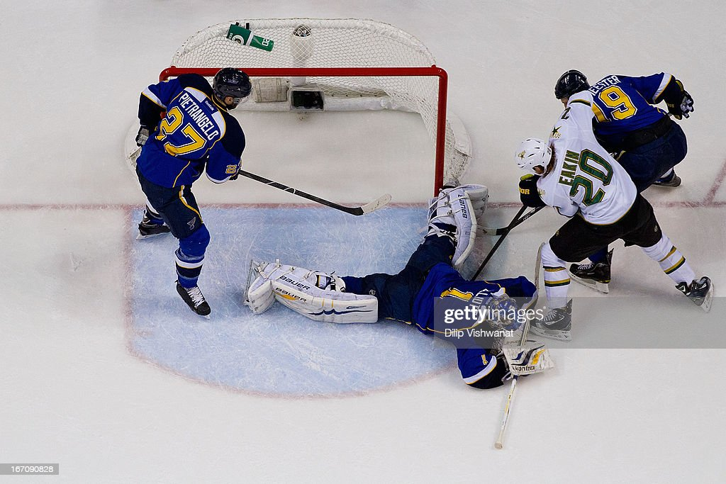 <a gi-track='captionPersonalityLinkClicked' href=/galleries/search?phrase=Brian+Elliott&family=editorial&specificpeople=687032 ng-click='$event.stopPropagation()'>Brian Elliott</a> #1 of the St. Louis Blues makes a save against <a gi-track='captionPersonalityLinkClicked' href=/galleries/search?phrase=Cody+Eakin&family=editorial&specificpeople=5662792 ng-click='$event.stopPropagation()'>Cody Eakin</a> #20 of the Dallas Stars as <a gi-track='captionPersonalityLinkClicked' href=/galleries/search?phrase=Alex+Pietrangelo&family=editorial&specificpeople=4072229 ng-click='$event.stopPropagation()'>Alex Pietrangelo</a> #27 and <a gi-track='captionPersonalityLinkClicked' href=/galleries/search?phrase=Jay+Bouwmeester&family=editorial&specificpeople=201875 ng-click='$event.stopPropagation()'>Jay Bouwmeester</a> #19 both of the St. Louis Blues defend during the third period at the Scottrade Center on April 19, 2013 in St. Louis, Missouri. The Blues beat the Stars 2-1.