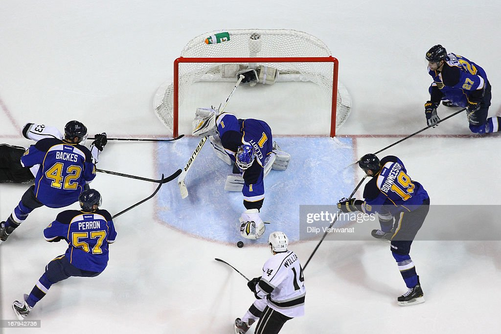 <a gi-track='captionPersonalityLinkClicked' href=/galleries/search?phrase=Brian+Elliott&family=editorial&specificpeople=687032 ng-click='$event.stopPropagation()'>Brian Elliott</a> #1 of the St. Louis Blues makes a save against Justin Williams #14 of the Los Angeles Kings in Game Two of the Western Conference Quarterfinals during the 2013 NHL Stanley Cup Playoffs at the Scottrade Center on May 2, 2013 in St. Louis, Missouri. The Blues beat the Kings 2-1.