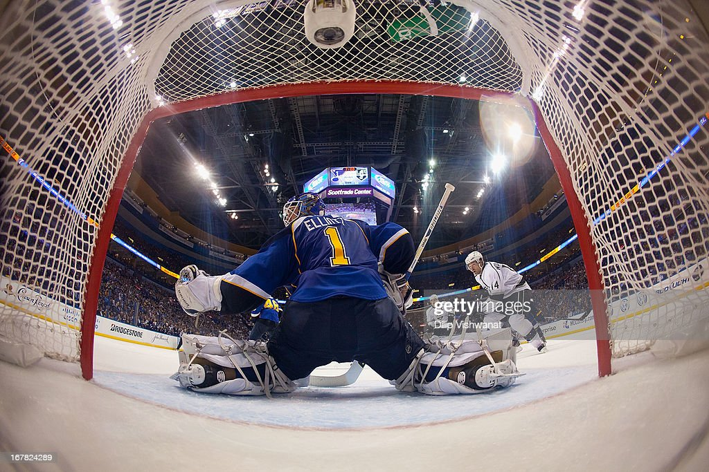 <a gi-track='captionPersonalityLinkClicked' href=/galleries/search?phrase=Brian+Elliott&family=editorial&specificpeople=687032 ng-click='$event.stopPropagation()'>Brian Elliott</a> #1 of the St. Louis Blues makes a save against Justin Williams #14 the Los Angeles Kings in Game One of the Western Conference Quarterfinals during the 2013 NHL Stanley Cup Playoffs at the Scottrade Center on April 30, 2013 in St. Louis, Missouri. The Blues beat the Kings 2-1 in overtime.