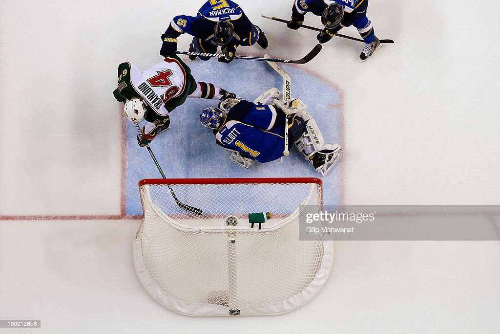Brian Elliott #1 of the St. Louis Blues makes a save against Mikael Granlund #64 of the Minnesota Wild at the Scottrade Center on January 27, 2013 in St. Louis, Missouri.
