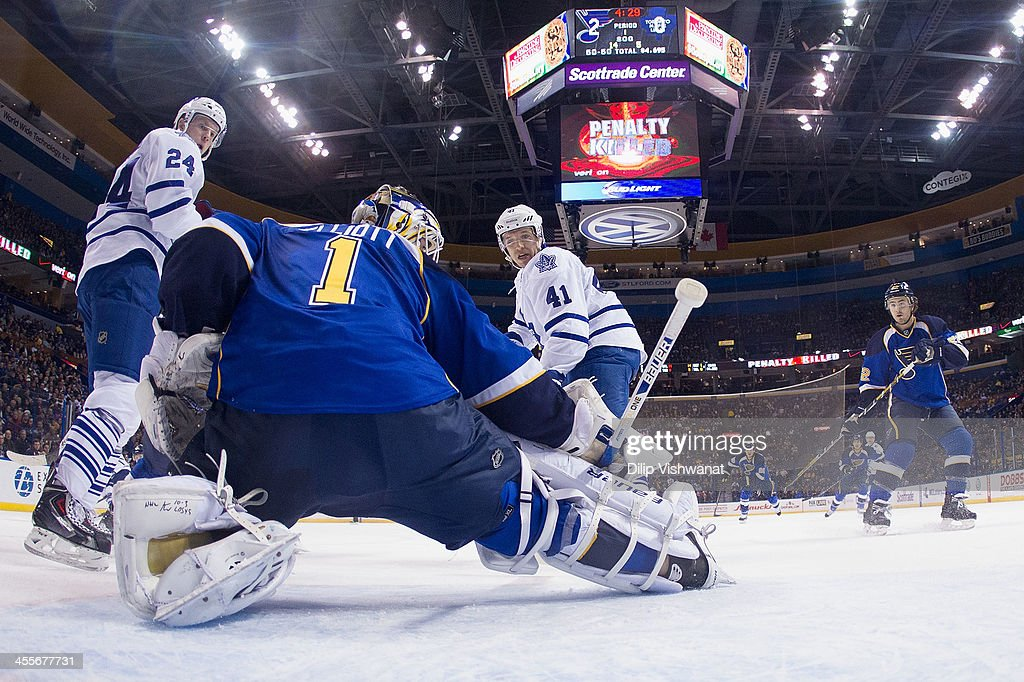 <a gi-track='captionPersonalityLinkClicked' href=/galleries/search?phrase=Brian+Elliott&family=editorial&specificpeople=687032 ng-click='$event.stopPropagation()'>Brian Elliott</a> #1 of the St. Louis Blues makes a save against <a gi-track='captionPersonalityLinkClicked' href=/galleries/search?phrase=Nikolai+Kulemin&family=editorial&specificpeople=537949 ng-click='$event.stopPropagation()'>Nikolai Kulemin</a> #41 and Peter Holland #24 of the Toronto Maple Leafs at the Scottrade Center on December 12, 2013 in St. Louis, Missouri. The Blues beat the Leafs 6-3.