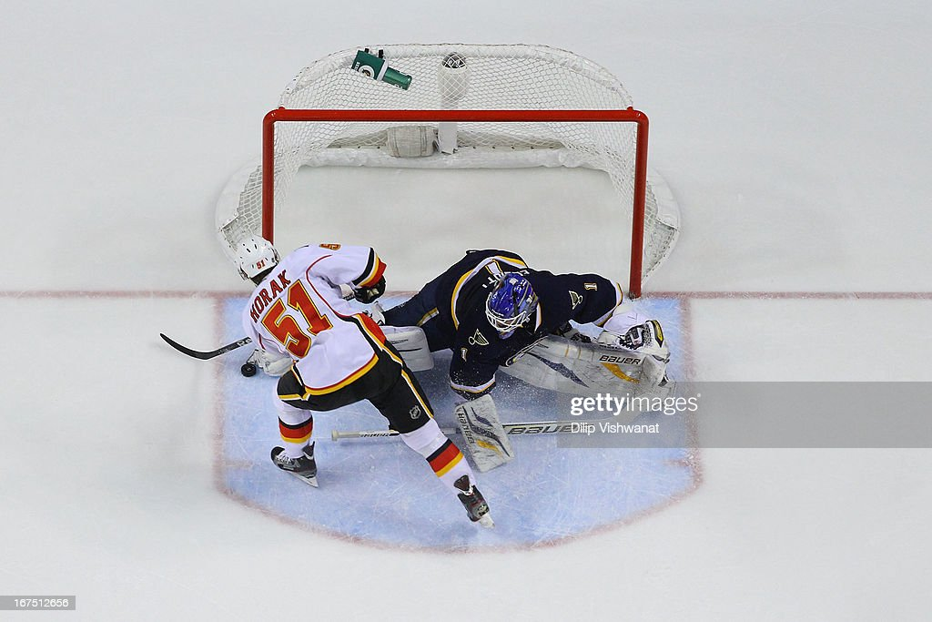 <a gi-track='captionPersonalityLinkClicked' href=/galleries/search?phrase=Brian+Elliott&family=editorial&specificpeople=687032 ng-click='$event.stopPropagation()'>Brian Elliott</a> #1 of the St. Louis Blues makes a save against <a gi-track='captionPersonalityLinkClicked' href=/galleries/search?phrase=Roman+Horak&family=editorial&specificpeople=5576313 ng-click='$event.stopPropagation()'>Roman Horak</a> #51 of the Calgary Flames during the third period at the Scottrade Center on April 25, 2013 in St. Louis, Missouri. The Blues beat the Flames 4-1.