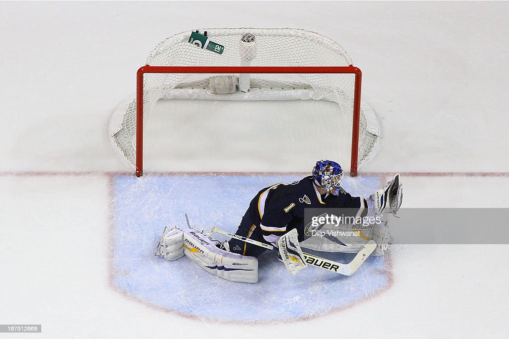 <a gi-track='captionPersonalityLinkClicked' href=/galleries/search?phrase=Brian+Elliott&family=editorial&specificpeople=687032 ng-click='$event.stopPropagation()'>Brian Elliott</a> #1 of the St. Louis Blues makes a save against the Calgary Flames during the third period at the Scottrade Center on April 25, 2013 in St. Louis, Missouri. The Blues beat the Flames 4-1.