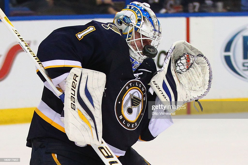 <a gi-track='captionPersonalityLinkClicked' href=/galleries/search?phrase=Brian+Elliott&family=editorial&specificpeople=687032 ng-click='$event.stopPropagation()'>Brian Elliott</a> #1 of the St. Louis Blues makes a save against the Detroit Red Wings at the Scottrade Center on February 7, 2013 in St. Louis, Missouri.