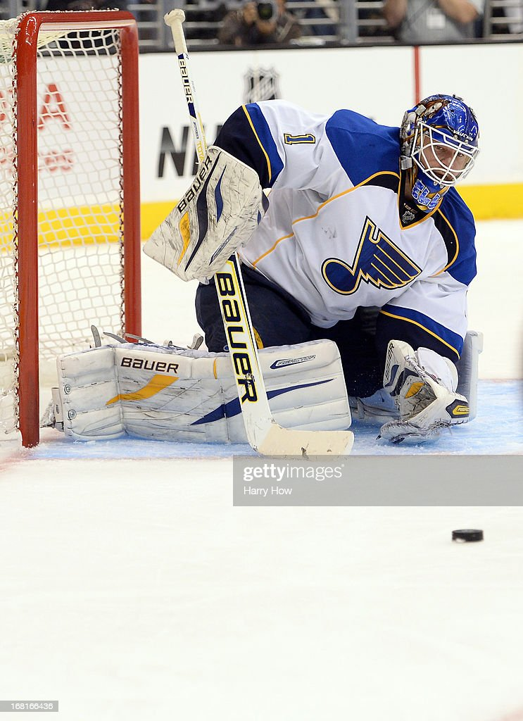 <a gi-track='captionPersonalityLinkClicked' href=/galleries/search?phrase=Brian+Elliott&family=editorial&specificpeople=687032 ng-click='$event.stopPropagation()'>Brian Elliott</a> #1 of the St. Louis Blues makes a save during a 1-0 loss to the Los Angeles Kings in Game Three of the Western Conference Quarterfinals during the 2013 NHL Stanley Cup Playoffs at Staples Center on May 4, 2013 in Los Angeles, California.