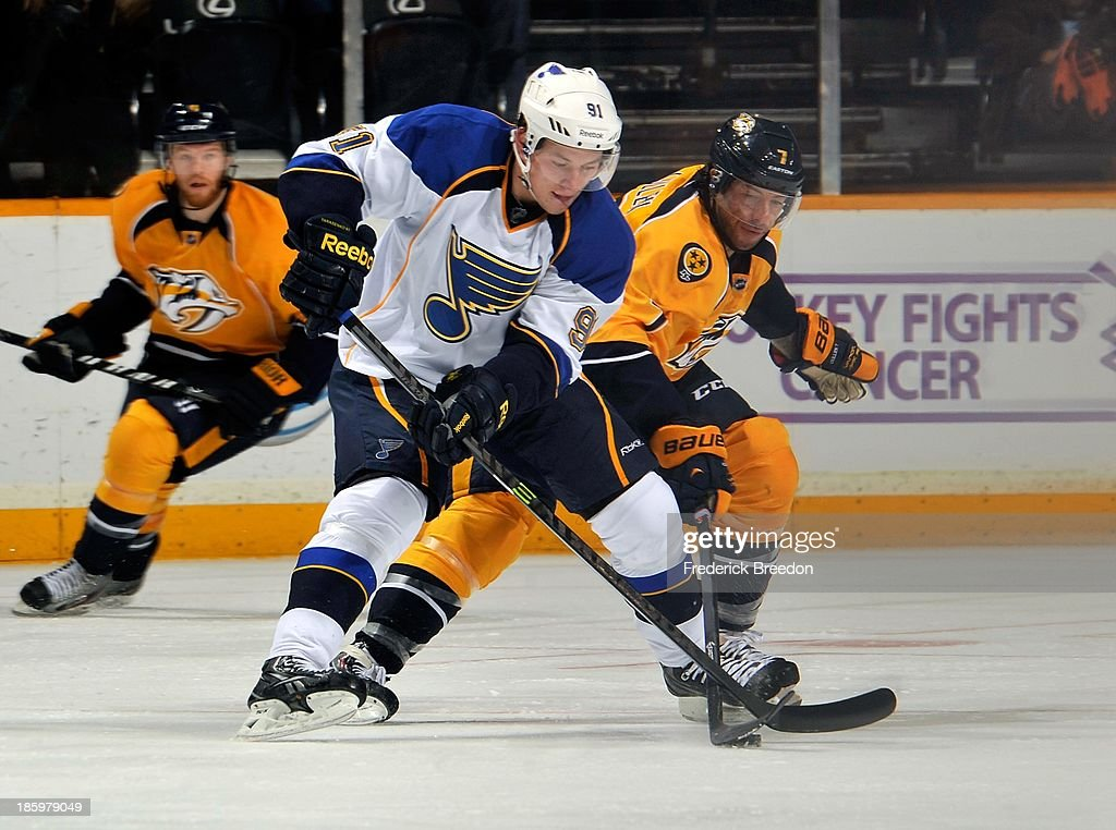 Brian Elliott #91 of the St. Louis Blues skates against <a gi-track='captionPersonalityLinkClicked' href=/galleries/search?phrase=Matt+Cullen&family=editorial&specificpeople=536122 ng-click='$event.stopPropagation()'>Matt Cullen</a> #7 of the Nashville Predators at Bridgestone Arena on October 26, 2013 in Nashville, Tennessee.
