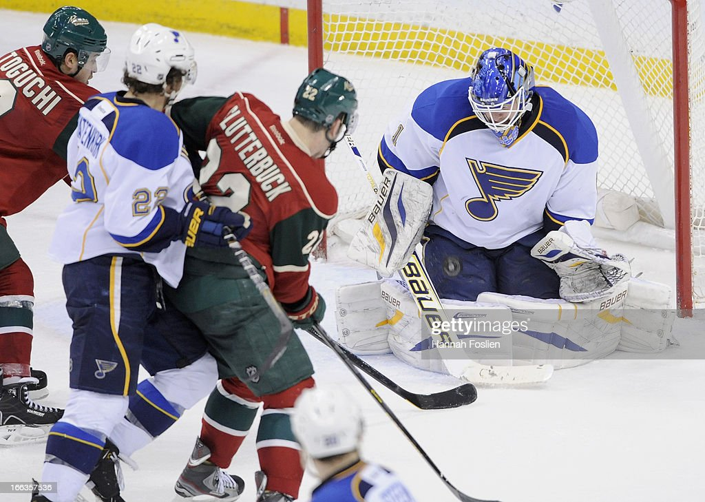 <a gi-track='captionPersonalityLinkClicked' href=/galleries/search?phrase=Brian+Elliott&family=editorial&specificpeople=687032 ng-click='$event.stopPropagation()'>Brian Elliott</a> #1 of the St. Louis Blues stops the shot by <a gi-track='captionPersonalityLinkClicked' href=/galleries/search?phrase=Devin+Setoguchi&family=editorial&specificpeople=2221039 ng-click='$event.stopPropagation()'>Devin Setoguchi</a> #10 of the Minnesota Wild as <a gi-track='captionPersonalityLinkClicked' href=/galleries/search?phrase=Kevin+Shattenkirk&family=editorial&specificpeople=4324986 ng-click='$event.stopPropagation()'>Kevin Shattenkirk</a> #22 of the St. Louis Blues and <a gi-track='captionPersonalityLinkClicked' href=/galleries/search?phrase=Cal+Clutterbuck&family=editorial&specificpeople=570497 ng-click='$event.stopPropagation()'>Cal Clutterbuck</a> #22 of the Minnesota Wild look on during the third period of the game on April 11, 2013 at Xcel Energy Center in St Paul, Minnesota. The Blues defeated the Wild 2-0.