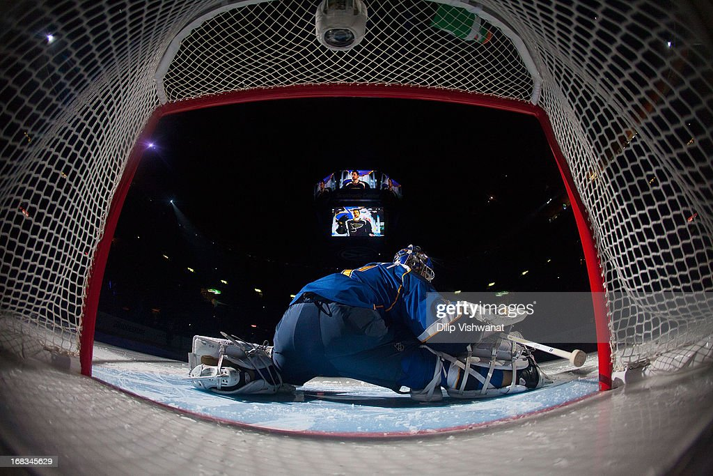<a gi-track='captionPersonalityLinkClicked' href=/galleries/search?phrase=Brian+Elliott&family=editorial&specificpeople=687032 ng-click='$event.stopPropagation()'>Brian Elliott</a> #1 of the St. Louis Blues stretches prior to playing against the Los Angeles Kings in Game Five of the Western Conference Quarterfinals during the 2013 NHL Stanley Cup Playoffs at the Scottrade Center on May 8, 2013 in St. Louis, Missouri. The Kings beat the blues 3-2 in overtime.