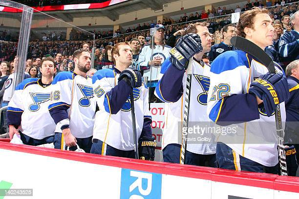 Brian Elliott Roman Polak Barret Jackman Kent Huskins and Kevin Shattenkirk of the St Louis Blues stand on the bench during the singing of the...