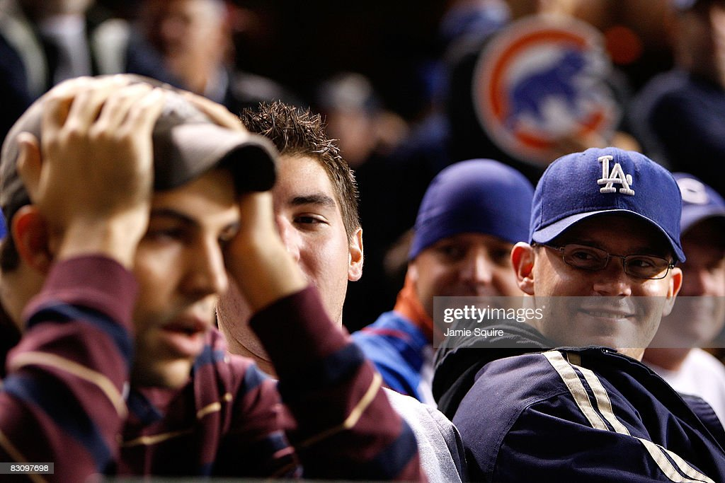 Brian Engler (R), a fan of the Los Angeles Dodgers looks towars a dejected Michael Piper (L), a fan of the Chicago Cubs in Game Two of the NLDS during the 2008 MLB Playoffs at Wrigley Field on October 2, 2008 in Chicago, Illinois. The Dodgers won 10-3.