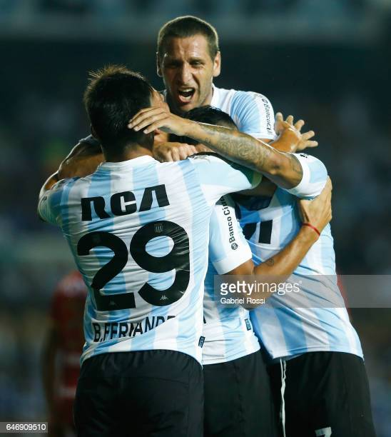 Brian Ezequiel Mansilla of Racing Club celebrates with teammates after scoring the first goal of his team during a first leg match between Racing and...