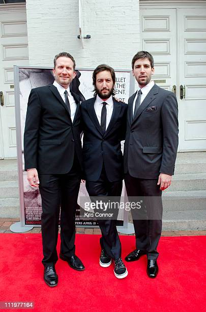 Brian Falk Greg Shapiro and Bill Holderman pose for photos on the red carpet during the premiere of 'The Conspirator' presented by The American Film...