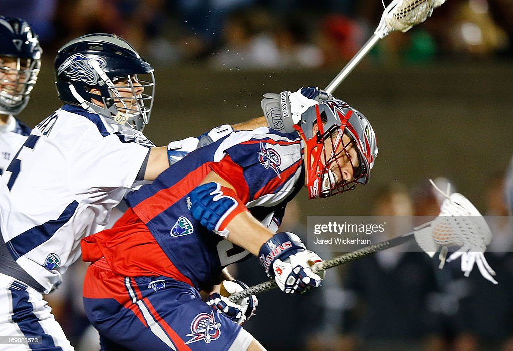 Brian Farrell #37 of the Boston Cannons is hit in the head by <a gi-track='captionPersonalityLinkClicked' href=/galleries/search?phrase=Kyle+Dixon&family=editorial&specificpeople=4451675 ng-click='$event.stopPropagation()'>Kyle Dixon</a> #5 of the Chesapeake Baykawks during the game on May 18, 2013 at Harvard Stadium in Boston, Massachusetts.