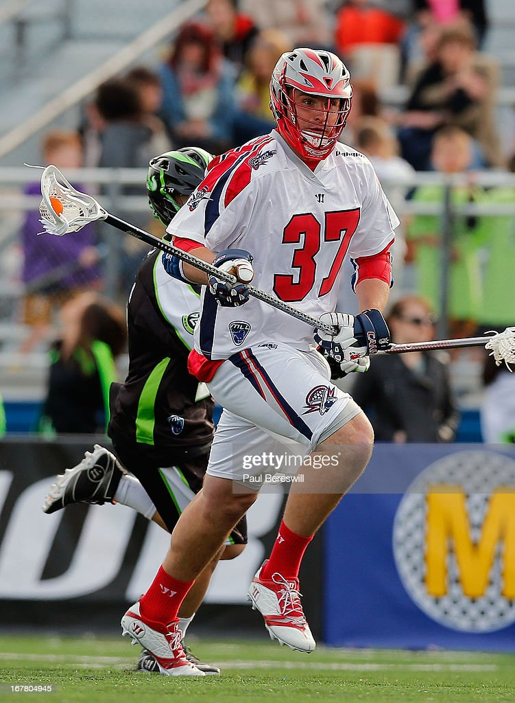 Brian Farrell #37 of the Boston Cannons runs with the ball during a Major League Lacrosse game against the New York Lizards at James M. Shuart Stadium on April 28, 2013 in Hempstead, New York.