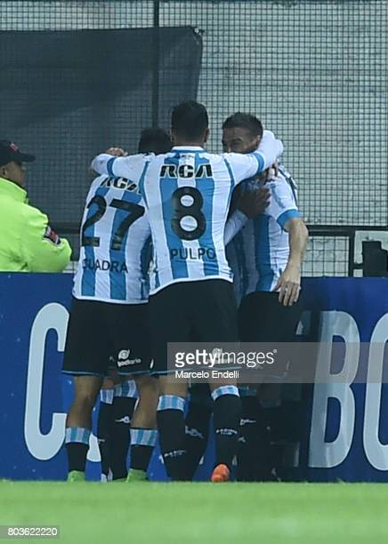 Brian Fernandez of Racing Club celebrates with teammates after scoring the second goal of his team during the first leg match between Racing Club and...