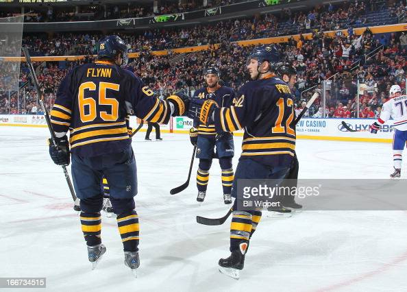 Brian Flynn of the Buffalo Sabres celebrates his goal with Kevin Porter against the Montreal Canadiens on April 11 2013 at the First Niagara Center...