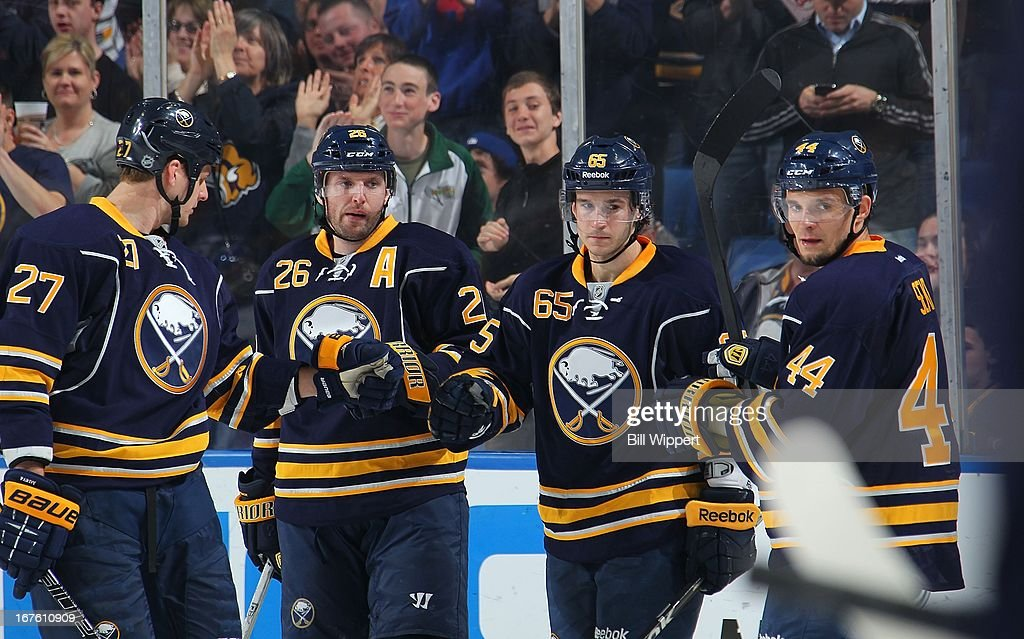 Brian Flynn #65 of the Buffalo Sabres celebrates his second-period goal against the New York Islanders with teammates Adam Pardy #27, Thomas Vanek #26, and Andrej Sekera #44 on April 26, 2013 at the First Niagara Center in Buffalo, New York.